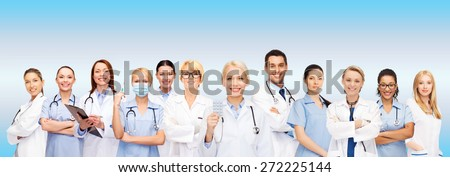 healthcare and medicine concept - smiling doctors and nurses with stethoscope - stock photo