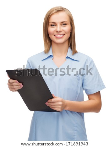 healthcare and medicine concept - smiling female doctor or nurse with clipboard