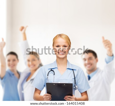 healthcare and medicine concept - smiling female doctor or nurse with stethoscope and clipboard - stock photo