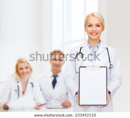 healthcare and medicine concept - smiling female doctor with stethoscope and clipboard and blank page - stock photo