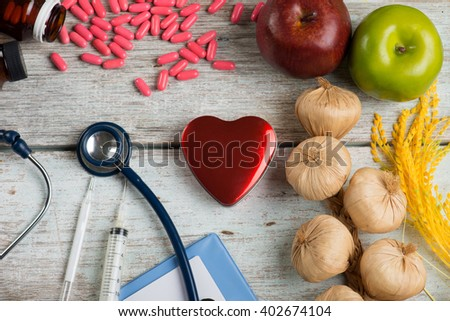 healthcare concept balance between medicine and healthy foods - stock photo