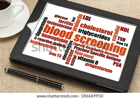 healthcare concept - blood screening word cloud on a digital tablet - stock photo