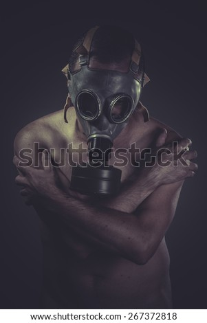 Healthcare, concept of risk of contamination, naked man with gas mask