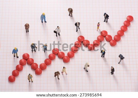 Healthcare costs for different people among graphic chart made by pills - stock photo