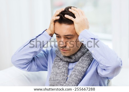 healthcare, flu, people and medicine concept - close up of ill man with flu suffering from headache at home - stock photo