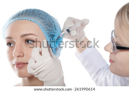 healthcare, medical and plastic surgery - beautician with patient doing botox injection in hospital - stock photo