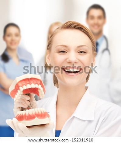 healthcare, medical and stomatology concept - attractive female doctor with big jaws - stock photo