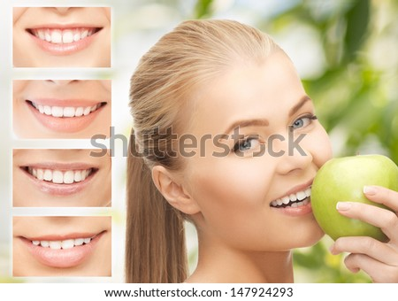 healthcare, medical and stomatology concept - female with apple and smiles