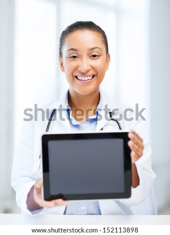 healthcare, medical and technology concept - african female doctor with tablet pc - stock photo