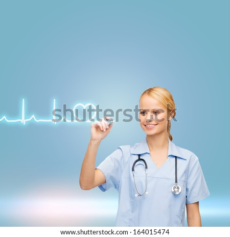 healthcare, medical and technology - young doctor or nurse drawing cardiogram - stock photo