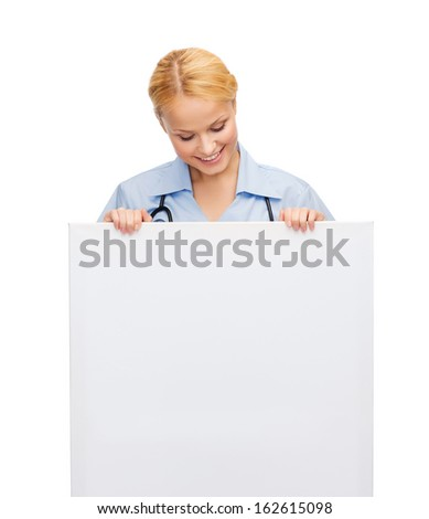 healthcare, medicine, advertisement and sale concept - smiling female doctor or nurse with stethoscope and white blank board - stock photo