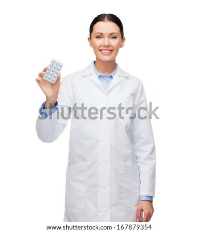 healthcare, medicine and pharmacy concept - smiling female doctor and with pills - stock photo