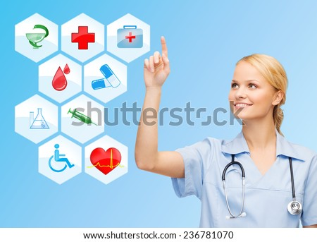 healthcare, medicine, people and symbols concept - smiling young female doctor or nurse with stethoscope pointing finger to medical icons over blue background - stock photo