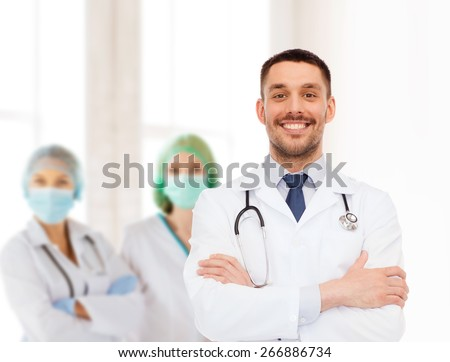 healthcare, profession and medicine concept - smiling male doctor with stethoscope in white coat over white background - stock photo