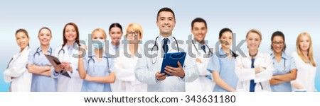 healthcare, profession, people, technology and medicine concept - international group of doctors with tablet pc computer and clipboard over gray background