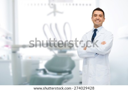 healthcare, profession, stomatology and medicine concept - smiling male middle aged dentist over medical office background - stock photo