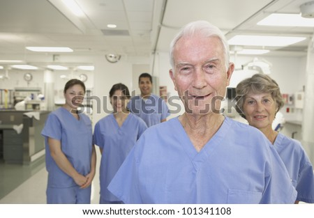 Healthcare professionals in hospital setting - stock photo
