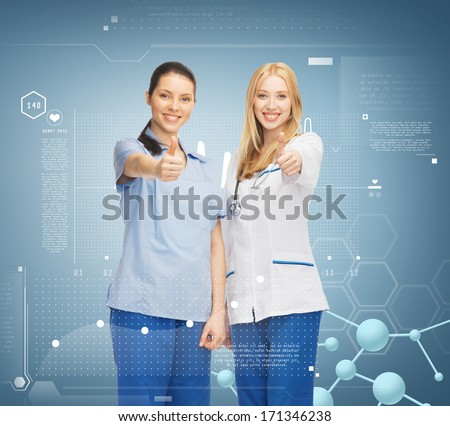 healthcare, research, science, chemistry and medical concept - two doctors showing thumbs up - stock photo