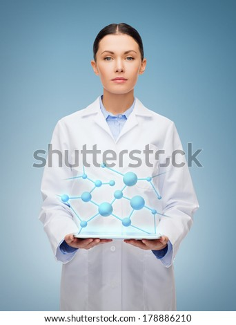 healthcare, technology and medicine concept - serious female doctor and tablet pc computer - stock photo
