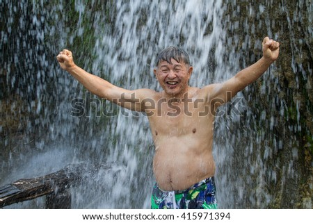 Healthy adults Holiday at Saiyok Noi Waterfall in the River Kwai Kanchanaburi of Thailand. - stock photo