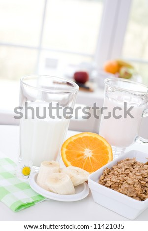 Healthy and delicious breakfast / cereal, yoghurt, orange, banana - stock photo