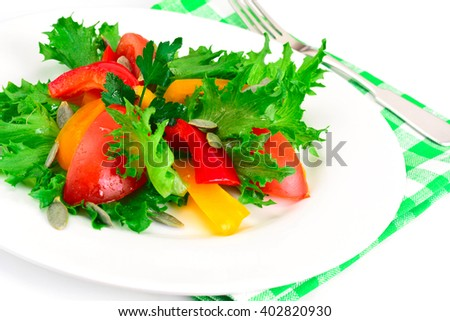 Healthy and diet food: Lettuce, tomato, pepper, seeds, oil, salt. Studio Photo