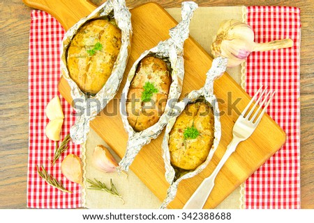 Healthy and Diet Food: Potatoes Roasted with Garlic and Ice Cream. Studio Photo. - stock photo