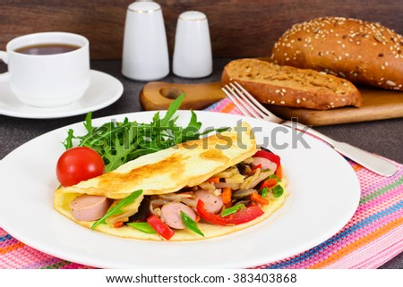 Healthy and Diet Food: Scrambled Eggs with Sausage and Vegetables. Studio Photo