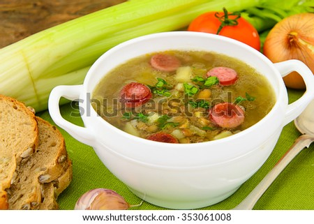 Healthy and Diet Food: Soup with Lentils, Celery and Sausage. Studio Photo