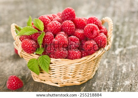 Healthy and fresh raspberries in the basket close up - stock photo