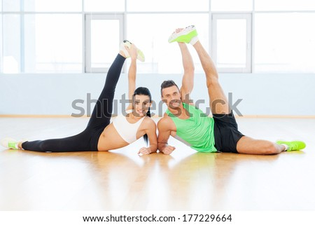Healthy and fresh. Sporty couple exercising at the fitness gym - stock photo