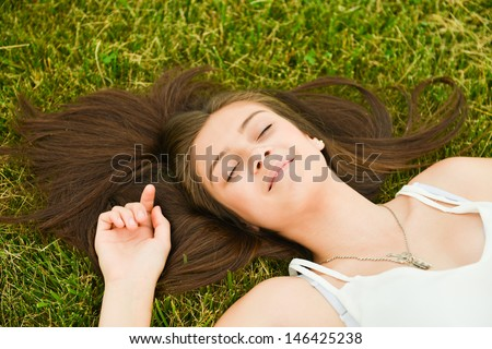 Healthy and happy woman enjoying her vacation in the park - stock photo