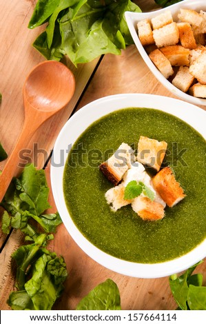 Healthy and homemade spinach soup in the bowl from above - stock photo