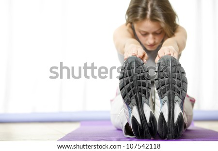 Healthy and motivated woman exercising and getting fit - stock photo