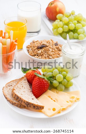 healthy and nutritious breakfast with fresh fruits and vegetables, vertical, close-up - stock photo
