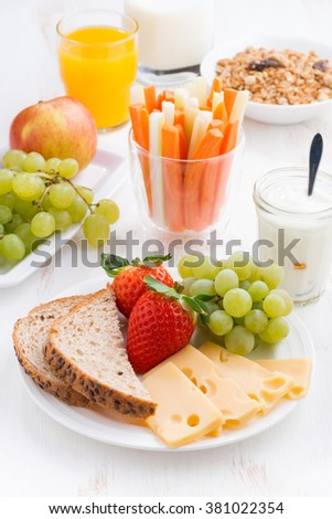 healthy and nutritious breakfast with fruits and vegetables, vertical, close-up