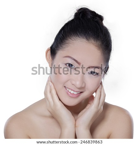 Healthy and smooth skin of the chinese female model smiling at the camera, isolated on white background
