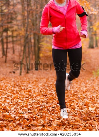 Healthy and sporty lifestyle. Young fit girl doing exercises on fresh air outdoor. Woman do fitness sport in autumnal forest.