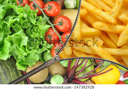 Healthy and unhealthy food zipper concept  - stock photo