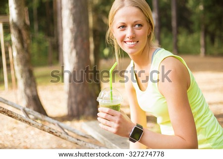 Healthy and young woman drinking smoothie