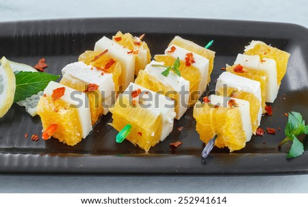 Healthy appetizer made with fruits and cheese - stock photo