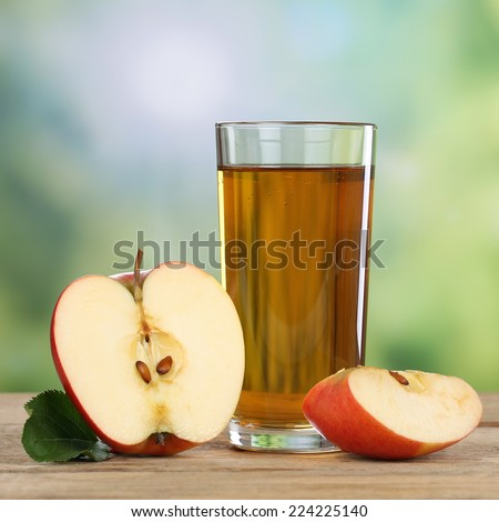 Healthy apple juice drink and red apples fruits in autumn - stock photo