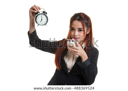 Healthy Asian woman drinking  glass of milk hold clock  isolated on white background.