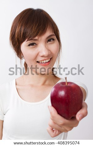 healthy asian woman giving red apple