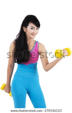 Healthy asian woman workout with two dumbbells, isolated over white background