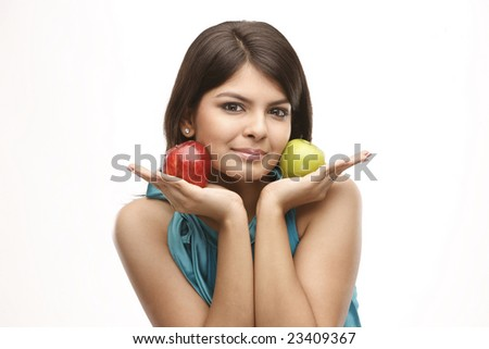 Healthy asian young girl with green and red apples - stock photo