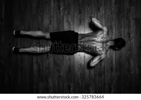 Healthy Athlete Doing Push Ups As Part Of Bodybuilding Training - stock photo