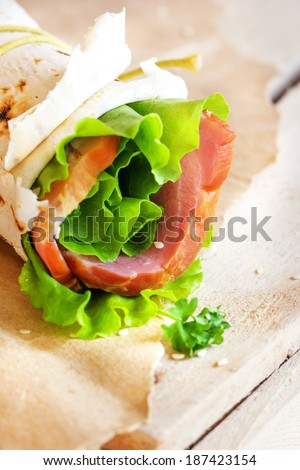 Healthy background with  ham and lettuce and pita