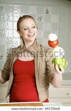 Healthy Balanced Diet, Woman balancing vegetables in the kitchen