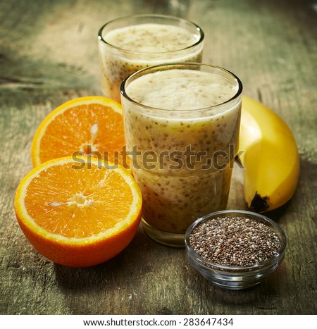 Healthy banana and orange juice smoothie with chia seeds, filtered image - stock photo